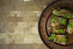 Delicious fried ribs, dressed with honey sauce, decorated with greens and vegetables stock photos