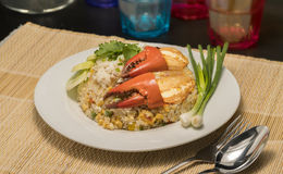 Delicious fried rice with crab. Thai fried rice with crab meat on white Royalty Free Stock Photo