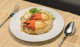 Delicious fried rice with crab. Thai fried rice with crab meat on white Royalty Free Stock Photography
