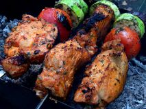 Delicious fried shish kebab with vegetables on a spit Stock Photography
