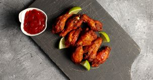 Delicious fried wings on board Stock Images