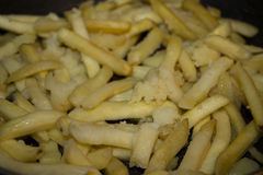 Delicious fries in the middle view. Mouthwatering Golden fries in the middle view Royalty Free Stock Image