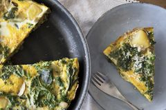 Frittata  in Pan with Slice Royalty Free Stock Photo