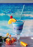 Frozen Blue Whale on the beach. Delicious frozen drink called a blue whale, with ice, lemonade, citrus vodka and curacao blue stock images