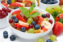 Delicious fruit and berry salad Stock Photos