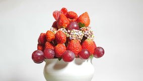 Delicious fruit bouquet spinning on a white background stock video