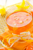 Delicious fruit jelly orange glass Stock Image