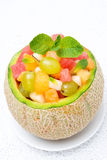 Delicious fruit salad in melon Royalty Free Stock Photo