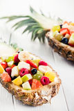 Delicious Fruit Salad in Pineapple on a Table Royalty Free Stock Images