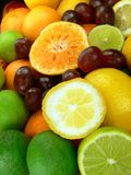 Delicious fruits. Grapes, lemons, limes, grapefruit and oranges Royalty Free Stock Photos
