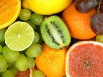 Delicious fruits. Kiwi fruit, lemon, lime, grapes, orange, grapefruit Royalty Free Stock Images