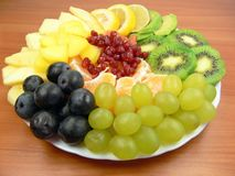 Delicious fruits. Grapes, orange, mango, apple, lemon, pomegranate, kiwi fruit Royalty Free Stock Images