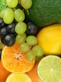Delicious fruits. Orange, grapes, lemon, lime and avocado Stock Photo
