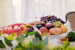 Delicious fruits and berries on the table. Beautiful delicious fruits and berries on a festive table Stock Photography