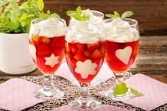 Delicious fruits jelly dessert in a glass with white gelatin sha Royalty Free Stock Photos