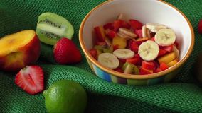 Delicious fruits salad in the bowl stock video