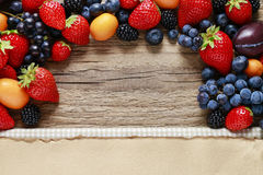 Delicious fruits on wood Royalty Free Stock Photos