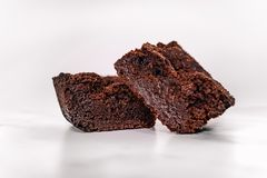 Delicious fudgy cocoa brownies isolated on white background. stock photo