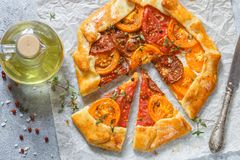 Delicious Galette with goat cheese, colorful tomatoes, thyme and spices stock photo