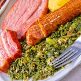 A delicious genuine oldenburger kale with peeked pinkel sausage stock images