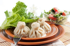 Delicious Georgian khinkali. Cooked pastry with meat Stock Image
