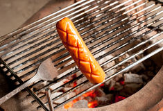 Delicious german sausages on the barbecue grill Royalty Free Stock Images