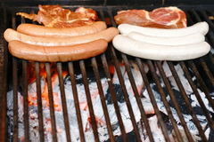 Delicious german sausiges on the  grill Stock Photo