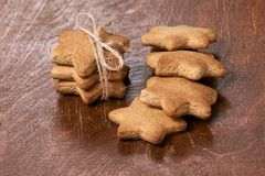 Delicious ginger biscuit. Beautiful gift. New Year. Dark brown background Royalty Free Stock Photography