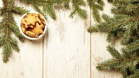 Delicious ginger biscuits. Fir branch. NewYear. Light background.  royalty free stock image