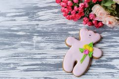 Delicious gingerbread cookie teddy bear with flowers royalty free stock image