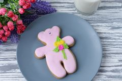 Delicious gingerbread cookie teddy bear with flowers Royalty Free Stock Photo