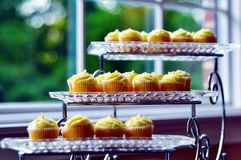 Delicious Glass Platters of Luxurious Cupcakes Royalty Free Stock Image