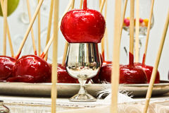 Delicious glazed apples on sticks. Christmas sweets Royalty Free Stock Photo
