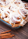 Delicious glazed cinnamon buns Royalty Free Stock Photos