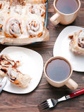 Delicious glazed cinnamon buns Stock Photo