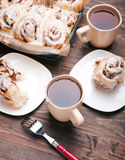 Delicious glazed cinnamon buns Royalty Free Stock Images
