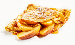 Delicious golden crepe with fresh apple filling. Delicious golden crepe with fresh apple and syrup filling in a close up view on a white background suitable for Stock Photo