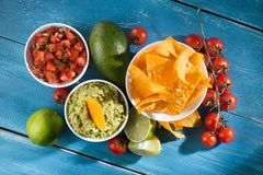 Delicious golden crispy chips with salsa and guacamole sauce. Mexican food. flat lay.top view royalty free stock photography