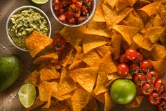 Delicious golden crispy chips with salsa and guacamole sauce. Mexican food. flat lay.top view royalty free stock images