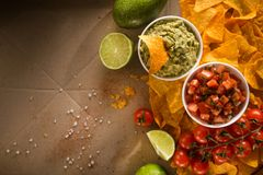 Delicious golden crispy chips with salsa and guacamole sauce. Mexican food. flat lay.top view stock photos