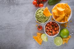 Delicious golden crispy chips with salsa and guacamole sauce. Mexican food. flat lay.top view stock images