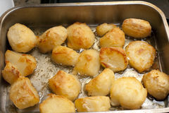 Delicious golden crispy roast potatoes Royalty Free Stock Photography