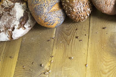 Delicious Golden pastries lies on an old kitchen Board Royalty Free Stock Photography