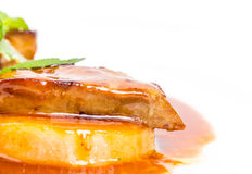 Delicious goose foie gras on baked pears. Royalty Free Stock Photography