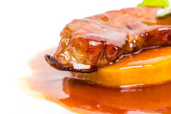 Delicious goose foie gras on baked pears. Stock Photography