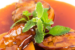 Delicious goose foie gras on baked pears. Stock Image