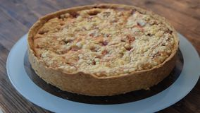 A delicious gooseberry cake with crumble on a rotary plate stock video