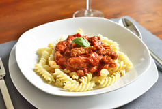 Delicious goulash dish on a white plate Stock Photo
