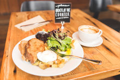 Delicious gourmet breakfast in upscale American cafe Royalty Free Stock Images