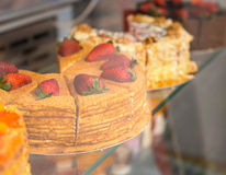 Delicious gourmet cakes in a bakery window Stock Images
